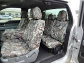 Durafit Covers.2004-2008 Ford F150 XL Super Cab Exact Fit Seat Covers. Front 40/20/40 Split Seat, Integrated Seat Belts,Solid Center Armrest. Rear Solid Back 60/40 Split Bottom Bench.Woodland Camo (Rear Center Seat Belt)