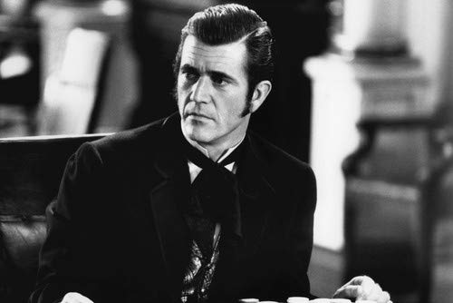 Mel Gibson in Maverick siting at card table with chips playing poker 24x36 Poster from Silverscreen