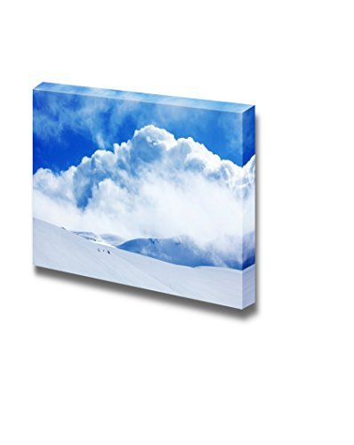 Winter Landscape of High Mountains with Snow Blizzard and Fresh Blue Sky Wall Decor ation