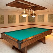 Auralex SonoLite 1-inch x 2-feet x 2-feet Sound Absorption Panels installed in a billiard room