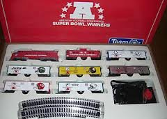 NFL Mantua Super Bowl HO Train Set. Super Bowl Express Engine and Caboose as well as the team cars--Raiders, Steelers, Dolphins, Colts, Jets, and (Express Caboose)