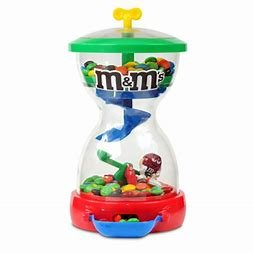 M&M M & M Candy Dispenser -- M&Ms Drop Onto SeeSaw To Raise Character -- as shown