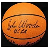 Signed Wooden, John Full Size Rawlings NCAA Basketball. (JSA Letter of Authenticity) autographed