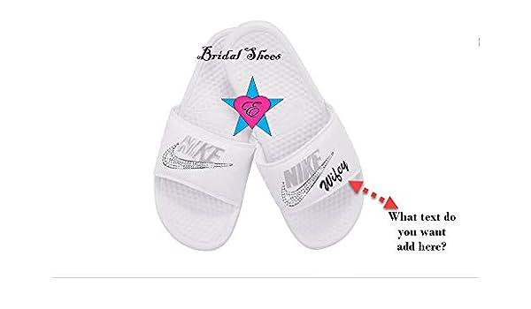 Amazon.com  Bedazzled Glitter Women s Nike Benassi Slides  5d18fc782f