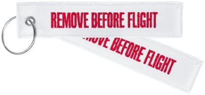 Llavero Remove Before Flight, blanco, . 13,5 x 3 cm