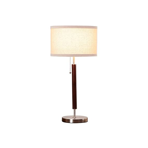 Brightech Carter Nightstand & Side Table Lamp - Contemporary Bedroom Lamp for Soft Bedside Light - Stainless Steel & Wood Finish - SIMPLE YET ELEGANT MODERN DESIGN: The Carter side table and desk lamp works well with a variety of interior design schemes such as urban, contemporary, mid century modern, minimalist, traditional, and industrial styles. This lamp adds a touch of elegance to your home or office with its neutral linen lamp shade that perfectly complements its Walnut Eucalyptus Wood Finish stem with brass accents. The Carter is one of the most versatile floor lamps that will look great on a side table or desk. BEAUTIFUL WARM LIGHT FOR HOME OR OFFICE: This table lamp gives off warm, beautiful light that will create a cozy, comfortable, and well-lit space for any room in your home or office. It provides soft yet plentiful lighting for your indoor space. This Lamp is the perfect bedside lamp, side table lamp, or executive office desk lamp that will provide comfortable lighting in any room. For added convenience, this UL Certified lamp is smart outlet compatible with Alexa, Echo, Dot, Google Home, etc. GORGEOUS CYLINDRICAL LAMPSHADE: The Carter Lamp's cylindrical lamp shade measures 18 inches in diameter and 9 inches in height and sits beautifully atop a Wooden Walnut Finish Stem with a weighted, sturdy base. The lampshade opens at the top and the bottom which diffuses the light and gives any room sufficient lighting with a calm, ambient glow. The neutral tones of this lampshade allow it to easily match and coordinate with any décor in your bedroom, living room, den, or office. - lamps, bedroom-decor, bedroom - 31Eo y K%2BuL. SS570  -