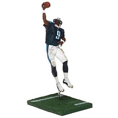 NFL Series 8 Figure: Steve McNair #9 with Navy Tennessee Titans Jersey: Toys & Games
