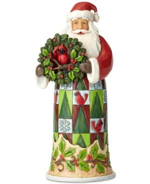 Enerco Jim Shore Santa Figurine Holding a Wreath with boughs of Holly and a Cardinal Peeking Through.