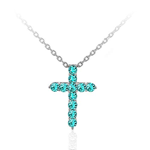 A Beautiful Expression of Faith. This Sparkling Cross Necklace is Adorned with Swarovski Crystals. 11 Vibrant Turquoise 2.45mm Round Crystals securely Set in a Rhodium Plated Brass. 1
