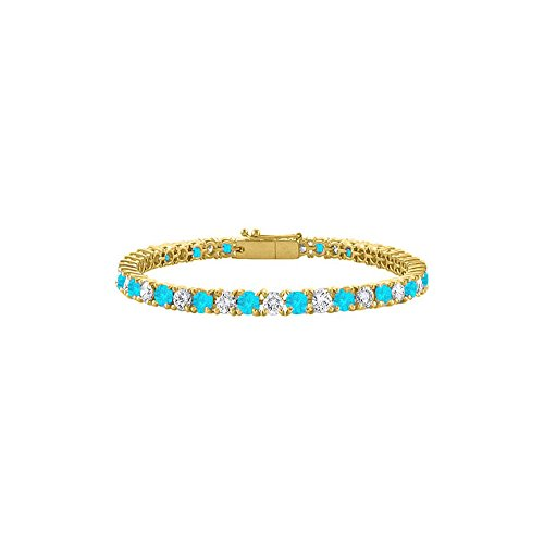 Created Blue Topaz and CZ Tennis Bracelet in 18K Yellow Gold Vermeil. 5 CT. TGW. 7 Inch