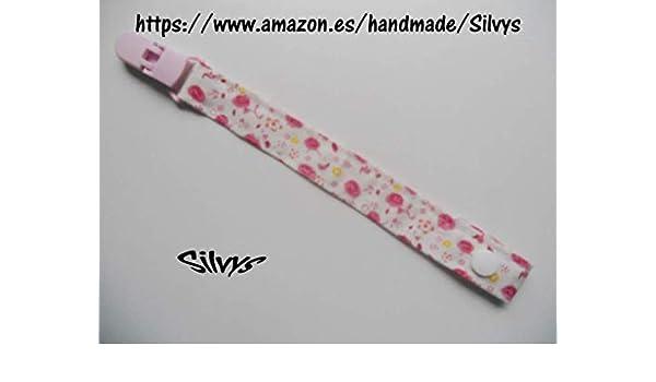 Chupetero de tela con clip Silvys, rosa y blanco con un ...