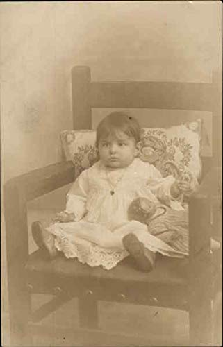 (Baby Posing on a Chair with a Doll Dolls Original Vintage Postcard)