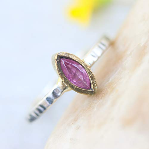 - Marquis pink sapphire in brass bezel setting with oxidized sterling silver texture design band