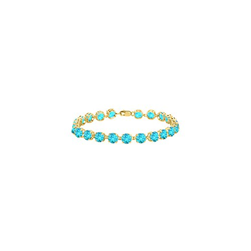 Created Blue Topaz Bracelet in 18K Yellow Gold Vermeil. 12 CT. TGW. 7 Inch