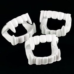 White Plastic Halloween Vampire Teeth - 24 Pieces