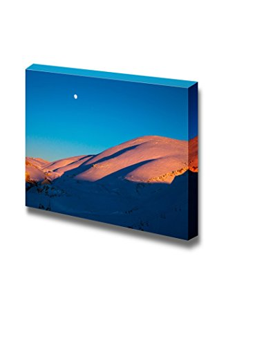 Beautiful Winter Landscape High Majestic Mountains Covered with White Snow in Bright Sunset Light Small Moon in Clear Blue Sky Wall Decor ation