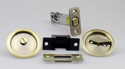 Kwikset 335 Round Bed/Bath Pocket Door Lock in Antique Brass