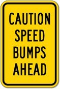 Caution Speed Bumps Ahead Sign - 12x18 - Black on Yellow Warning Sign