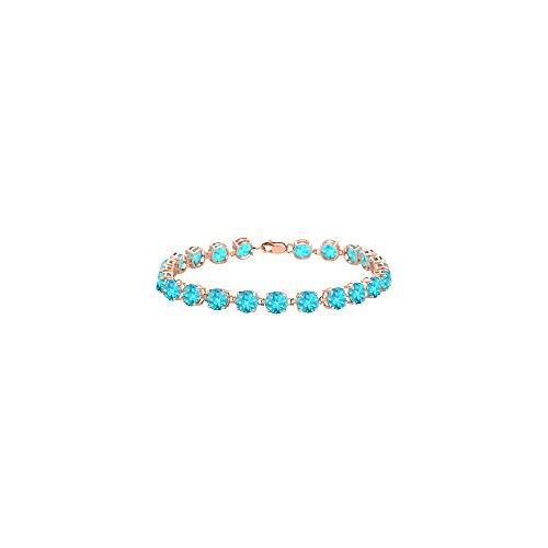 Created Blue Topaz Tennis Bracelet in 14K Rose Gold Vermeil. 12 CT. TGW. 7 Inch