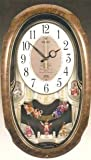 Seiko QXM116brh Melodies in Motion Oval Puppets clock