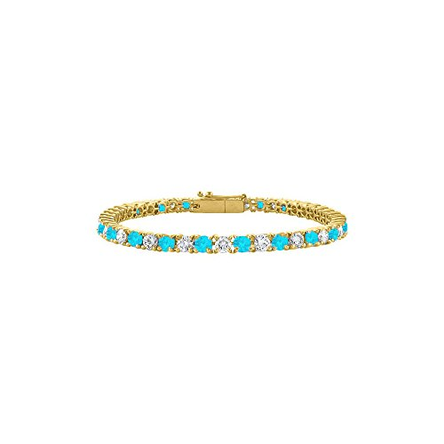 CZ and Created Blue Topaz Tennis Bracelet in 18K Yellow Gold Vermeil. 3 CT. TGW. 7 Inch