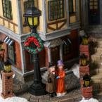 12.5 in. Animated Holiday Downtown, LED Lighted Animated Snowy Christmas Village House Scene by Home Accents Holiday (Image #1)