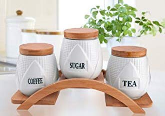 Set Of 3 White Tea Coffee And Sugar Ceramic Storage Jars With Bamboo Base Airtight Sealed Canisters On A Wooden Raised Stand By Home Decor Studio