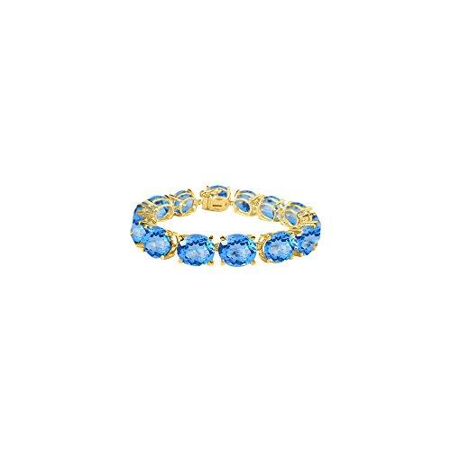Oval Blue Topaz Bracelet in 18K Yellow Gold Vermeil 50 CT TGW - December Birthstone Jewelry
