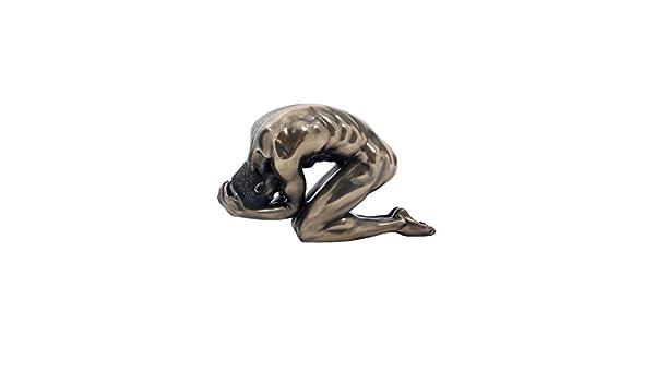 Black male bending over nude seems