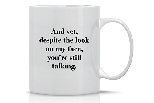 And Yet, Despite the Look On My Face, You're Still Talking - Funny Sarcasm Mug