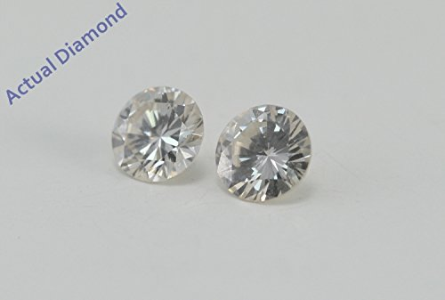 Une paire de Diamants Rond taillés (0.55 Ct, I Couleur,SI1 Clarté)