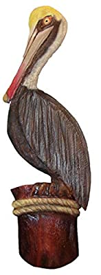 carved wooden pelican wall art