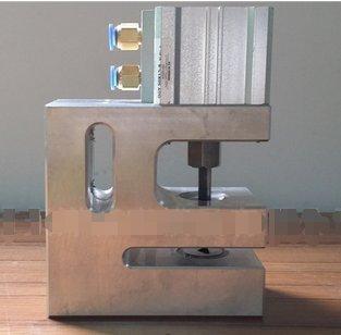 Pneumatic plastic bag triangular hole punch machine by Huanyu Instrument