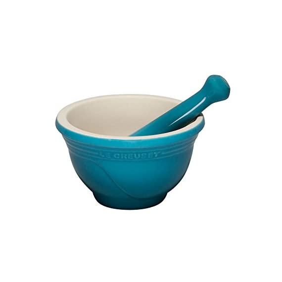 Le Creuset Stoneware 10-Ounce Mortar and Pestle, Caribbean 1 10-ounce mortar and pestle for preparing flavorful herbs, spices, and pestos Made of high-fired stoneware with enamel exterior; resists chipping and cracking Unglazed, abrasive interior and pestle tip for efficient crushing and grinding