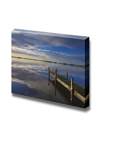 Landscape in Holland with a Calm Lake and Sunset Wit a Jetty Wall Decor ation