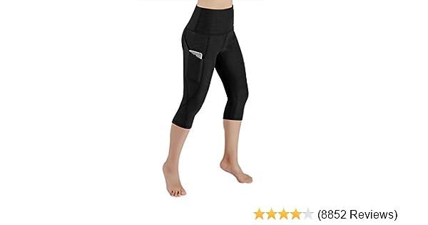 d19e2bc1235c2 Amazon.com: ODODOS High Waist Out Pocket Yoga Capris Tummy Control Workout  Running 4 Way Stretch Yoga Pants,Leggings: Clothing