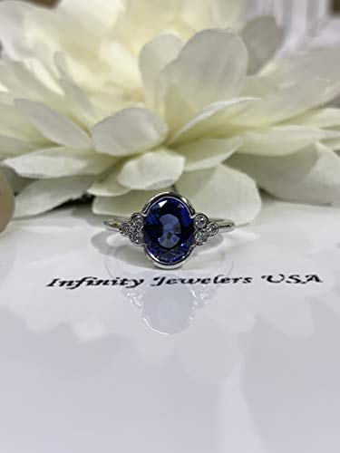 Oval Ceylon blue sapphire with round diamond accents engagement ring ()