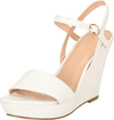 This sandal from Cambridge Select features an open toe, single vamp band, adjustable buckled ankle strap, and generous platform sole to balance high wedge heel. Imported.