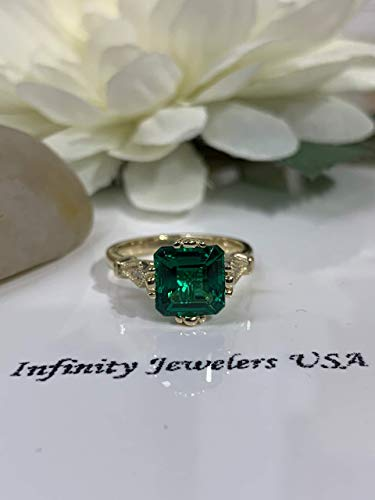 (Asscher cut green emerald with diamond accents vintage style engagement ring)