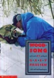 img - for Woodsong Unknown edition by Paulsen, Gary (1990) Paperback book / textbook / text book