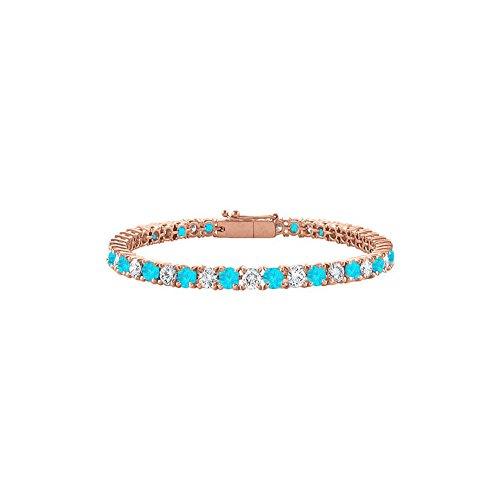 Cubic Zirconia and Created Blue Topaz Tennis Bracelet in 14K Rose Gold Vermeil. 5CT. TGW. 7 Inch