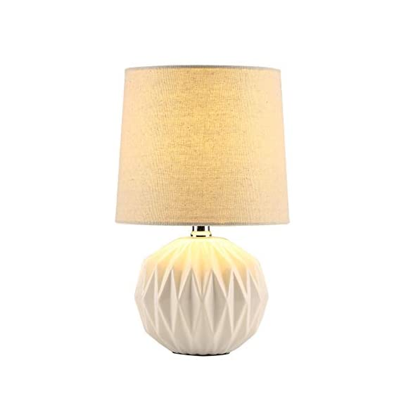 "Tayanuc Small Geometric Ceramic Bedside Nightstand Table Lamp, White Textured Desk Lamp Linen Drum Fabric Shade for Living Room Family Bedroom - Ceramic Table Lamp: This white ceramic table lamp shaped like a pineapple takes a fresh twist with textural geometric ceramic body. The solid color allows the plentiful texture and modern silhouette to truly shine and adds a hint of glam to nightstand. Excellent gifts for the coming Thanksgiving Day. Materials: The inimitable desk lamp will turn heads with its smooth textured curves balanced on a white ceramic base. It is paired with beige linen drum fabric shade that casts an ambient glow. Dimensions: 7.5"" D x 12.6"" H. - lamps, bedroom-decor, bedroom - 31aacf4zrtL. SS570  -"