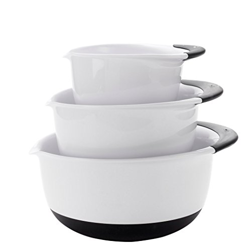 White mixing bowls with handles for easy usage.