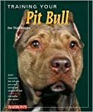 img - for Training Your Pit Bull by Jos Stahlkuppe, Michele Earle-Bridges (Illustrator) book / textbook / text book