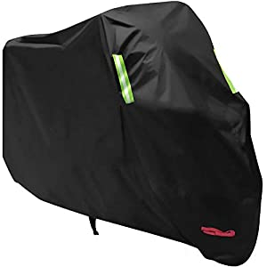 Black motorcycle cover over bike
