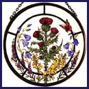 - Decorative Hand Painted Stained Glass Window Sun Catcher/Roundel in a Scottish Flowers Design