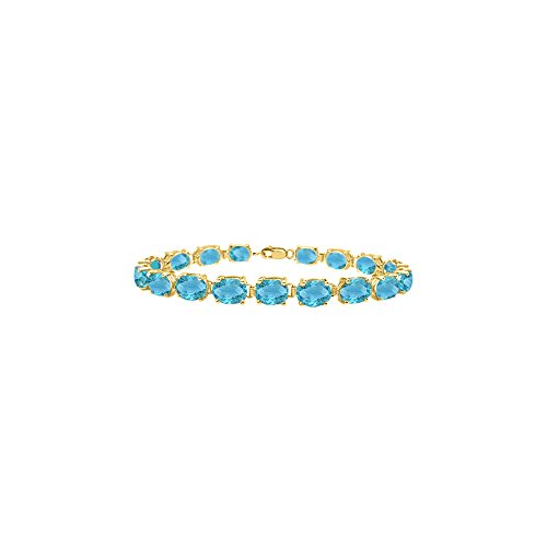 Tennis bracelets oval cut created blue topaz in sterling silver 18K yellow gold vermeil 15ct -