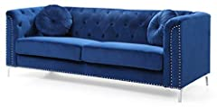 Soft velvet button tufting on the inside of the arms and backs along with the pocketed Coil cushion seats make this set comfortable and stylish. Nailhead trimmed and finished off with chrome plated legs add glamorous accents to this set. . Kd...