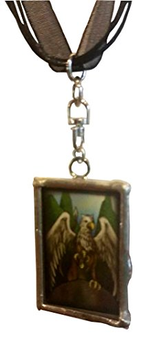 Griffon Reversible Pendant that says