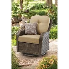 - All-Motion Beige Outdoor Wicker Swivel Glider Chair With 1 cushioned all-motion chair , 1 toss pillow and rust-resistant steel frame